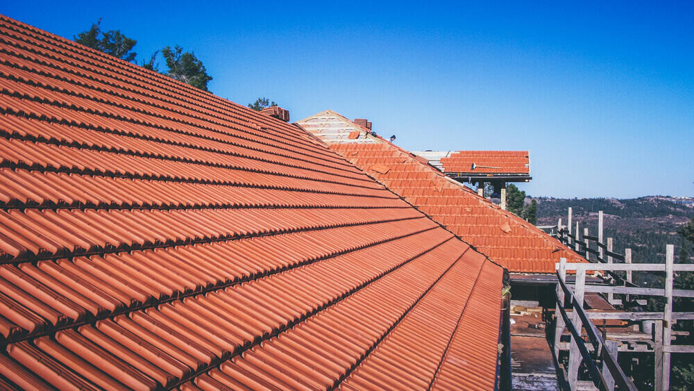 roof endova made of natural brick-colored tiles. roofing