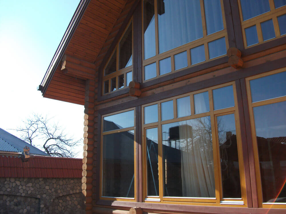 panoramic windows on a wooden house